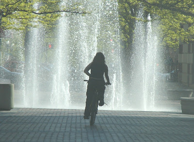 Image of bicyclist near water fountain in downtown Boise