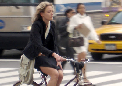 Image of stylish woman on bicycle