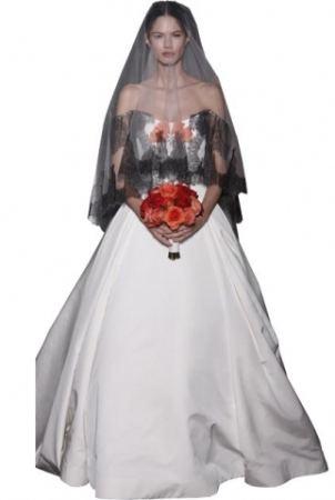 9487d685ac Impactante el vestido de novia con velo negro y un coqueto ramo de novia en  rojo
