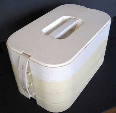 White rounded corner object that looks like a bread box
