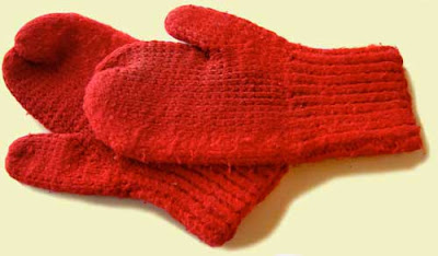 Bright red pair of handknit mittens