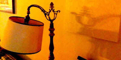 Lamp casting a shadow that looks like a genie's lantern