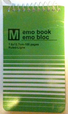 Green notepad cover that says emo book emo bloc with a white M in a black square over to the left of the words