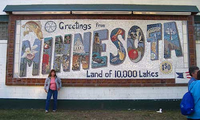 Wall mosaic that looks like a classic Greetings from Minnesota postcard