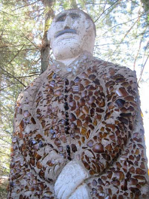 Looming statue covered with brown glass