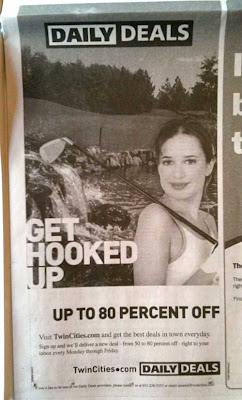Newspaper ad with large headline GET HOOKED UP along with photo of pretty young woman with a golf club