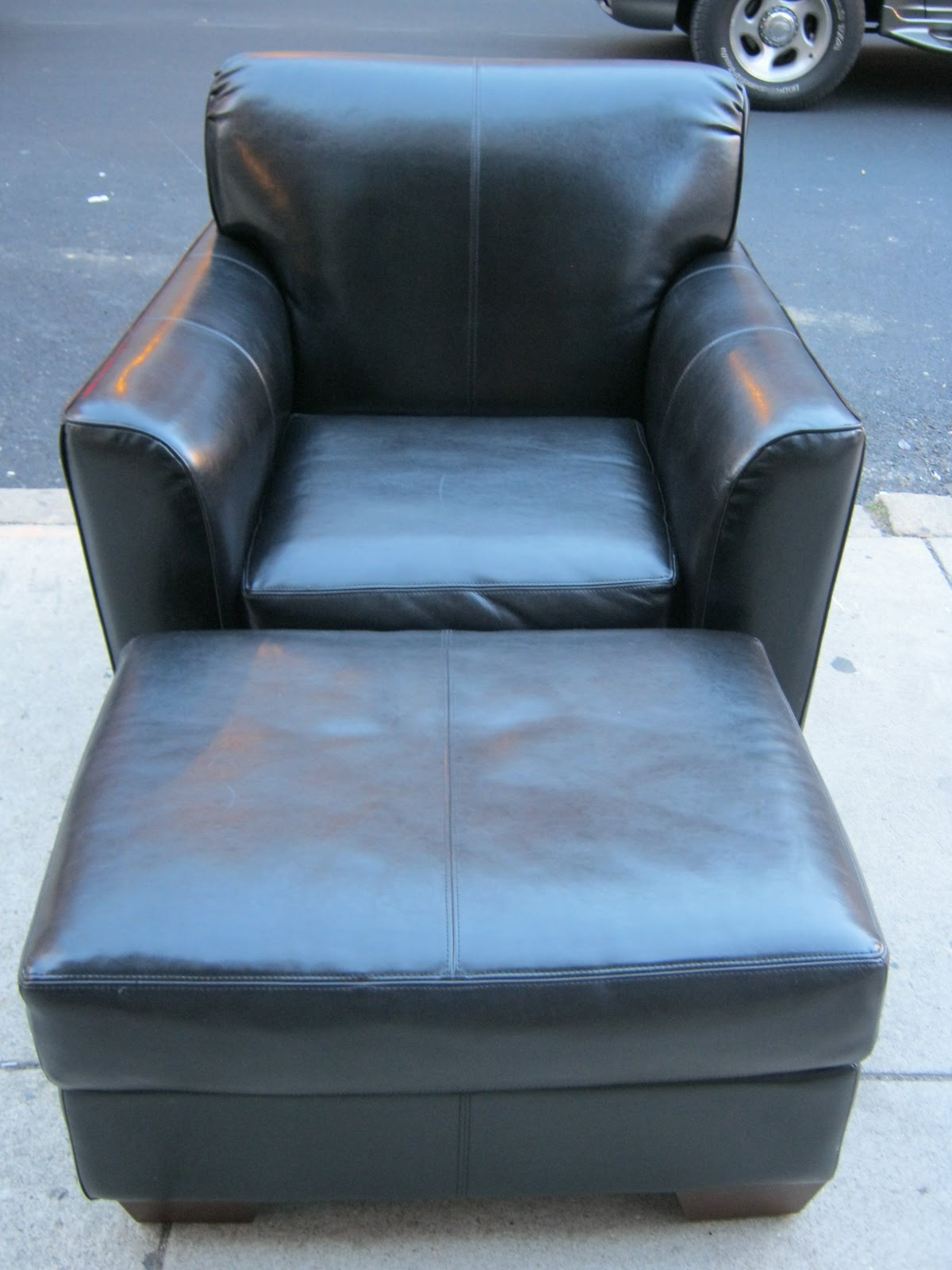 Black Leather Chair And Ottoman Sold