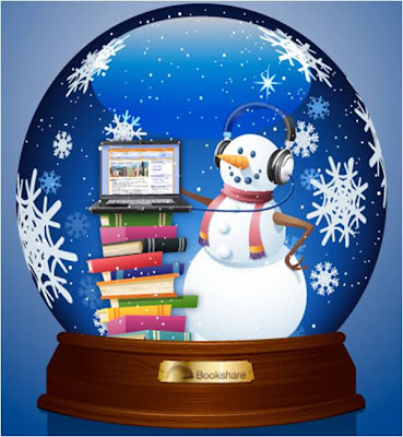 Snow globe with snowman, stack of books and laptop displaying Bookshare