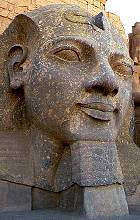 Ramesses head II beside his pylon at Luxor Temple