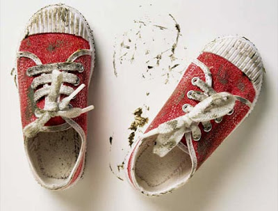 A child's muddy shoes