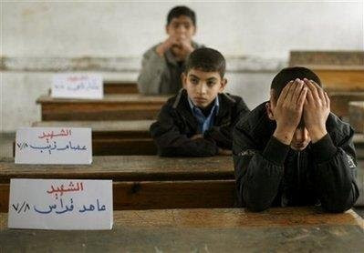 Gaza+students+back+to+school-+the+cards+name+the+students+killed+by+Israel.jpg