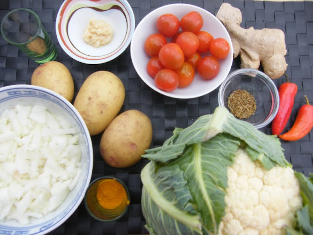 Ingredients for Potato and Cauliflower Curry including potatoes, cauliflower, onion and spices