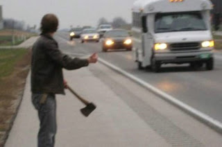 picture of a guy holding an axe and hitch-hiking