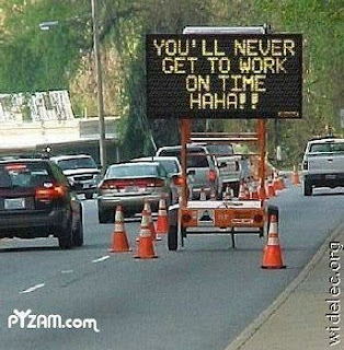 electronic road sign that taunts people that they will not get to work on time