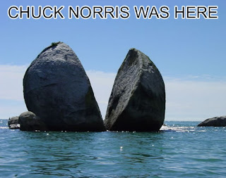 photo of a huge boulder split in half and a caption...chuck norris was here