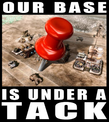cartoon of a giant tack stuck in the middle of a base and the caption reads our base is under a tack