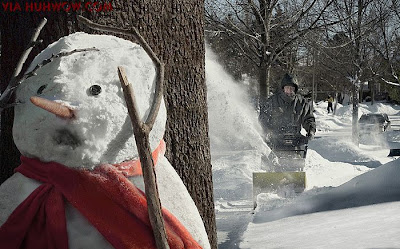 picture of a snowman cowering in fear of a snowblower