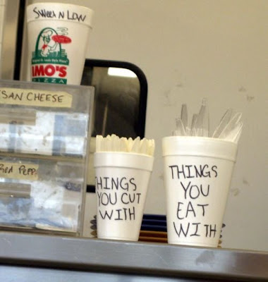 photo of funny writing on cups holding utensils
