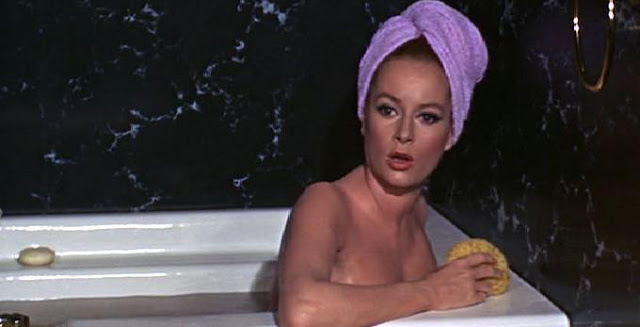 Here for no particular reason is a picture of the hot redhead from Thunderball in a bathtub. I think her name is Tunsa Redbush.