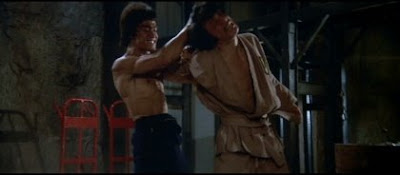 Bruce Lee wipes the floor with a young Jackie Chan's ass.