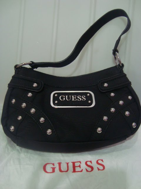75a1fd45f4 Guess Network Small Shoulder Bag New with tag. Gorgeous black Guess handbag~  the perfect accessory for any wardrobe! Made of matte finish black faux  leather ...