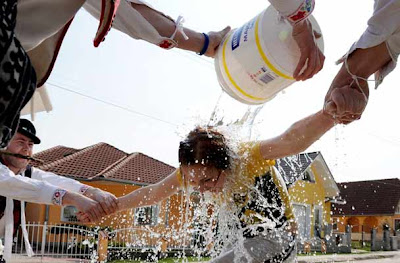 Men in traditional Slovak clothes throw buckets of cold water on women in a Selec village 120 km east of Bratislava