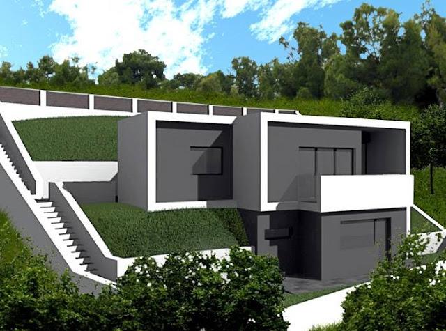Casa minimalista sobre terreno en pendiente con terrazas