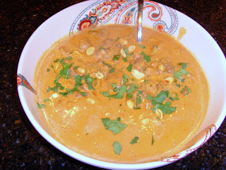 A bowl of chicken in spicy Thai peanut sauce