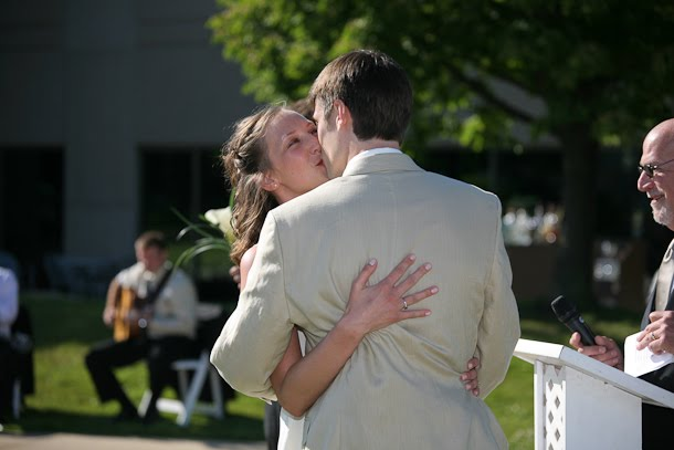 Ellie kisses John at their Harbor Lights Room wedding in downtown Milwaukee Wisconsin