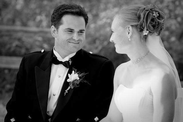 Groom exchanging smile with bride at outdoor Lapham Peak wedding
