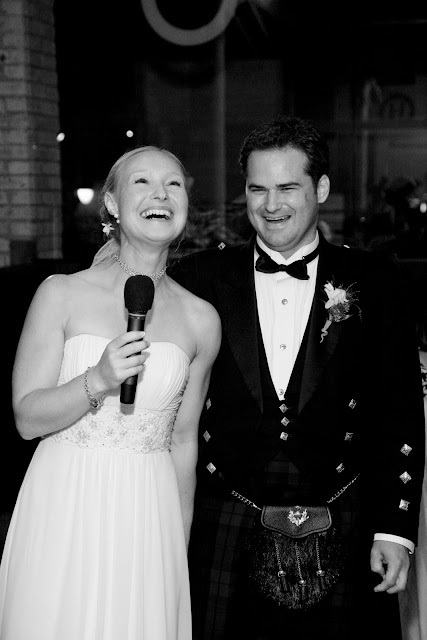 Bride and groom laughing as they welcome guests to Hinterland Erie Street Gastropub wedding reception