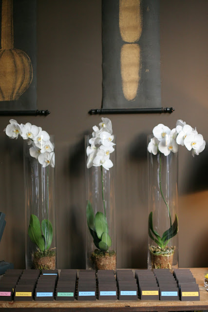 Tall vases and placecards for wedding reception at Hinterland Erie Street Gastropub