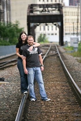 Engagement portrait on railroad tracks in downtown Milwaukee