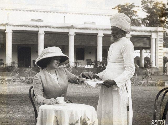 Indian servant serving tea