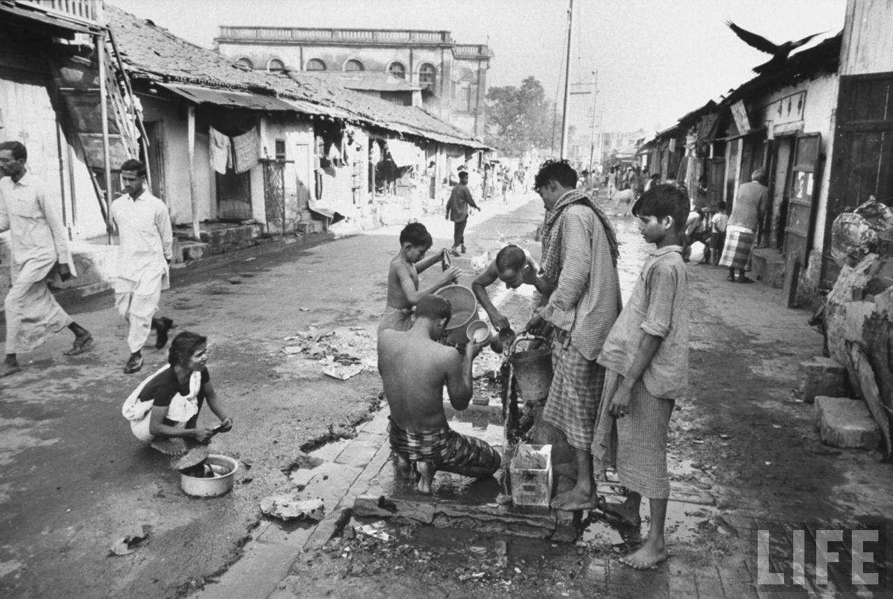 Residents of Calcutta (Kolkata) bathing in the streets - December 1970