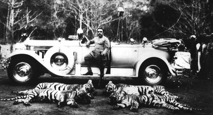 Man Posing with Four Dead Tigers and a Car - Date Unknown