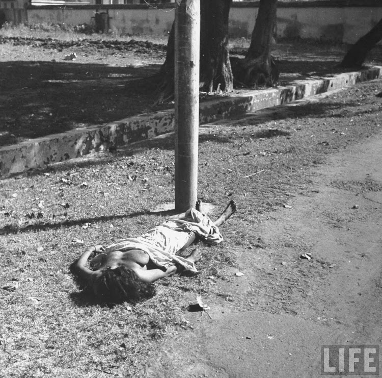 An Bengali girl lying on the roadside, died in her sleep