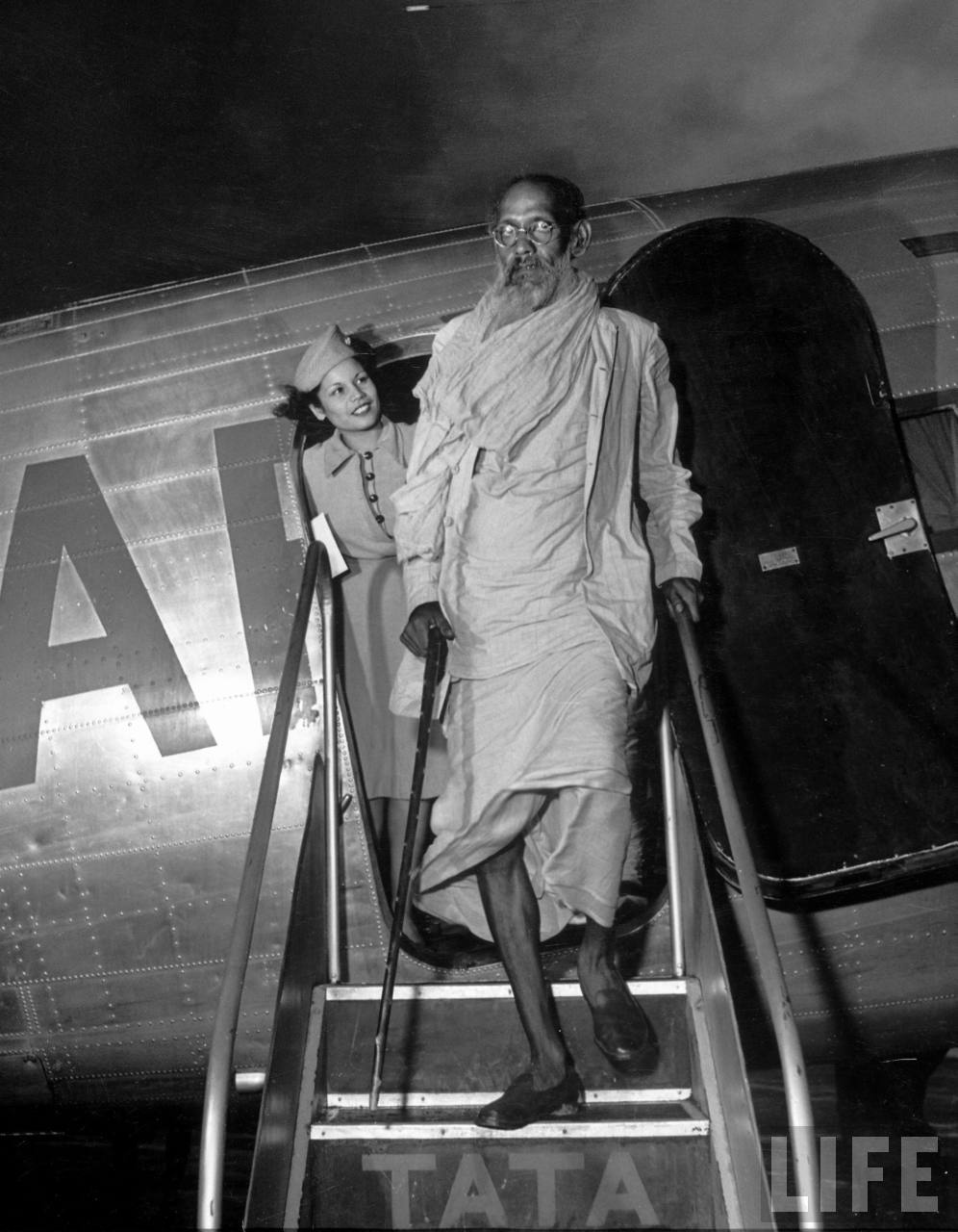 Flight Attendant Avenell Divers (L) saying goodbye to Sunyasi ascetic after flight on Air India.