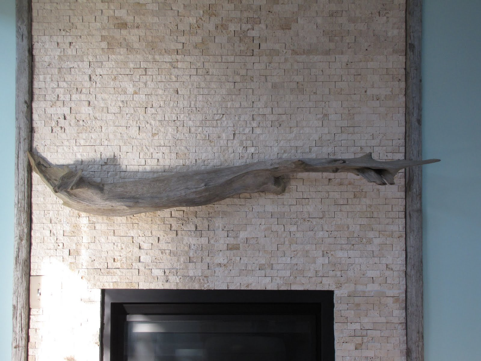 By The Sea Our Driftwood Fireplace Mantle