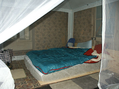 Bed set up inside in a tent while we renovate.  Indre et Loire, France. Photographed by Susan Walter. Tour the Loire Valley with a classic car and a private guide.