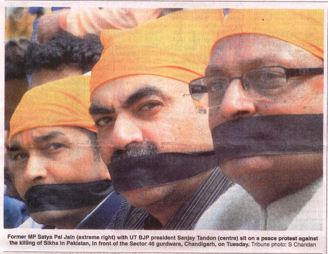 Former MP Satya Pal Jain with UT BJP president Sanjay Tandon sit on a peace protest against the killing of Sikhs in Pakistan, in front of the Sector 46 gurdwara, Chandigarh