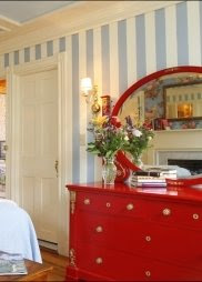 red dresser in coastal bedroom
