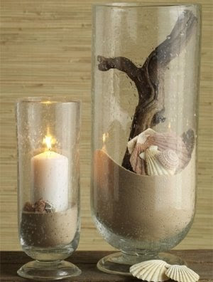 seashells in glass hurricane vase