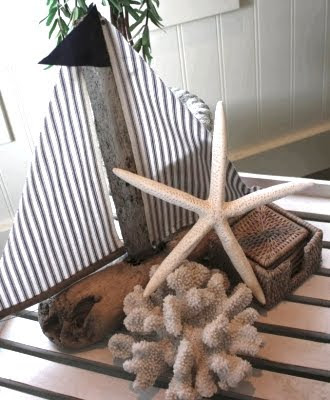 small handcrafted driftwood sailboat for decor