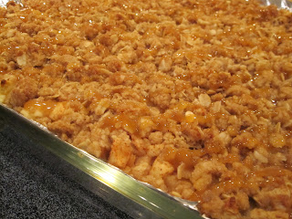 Caramel Apple Cheesecake bars start with a delicious crust, a creamy cheesecake filling, chopped apples and are topped with a sweet streusel topping. Life-in-the-Lofthouse.com