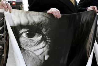 Relatives of Srebrenica victims hold photos relating to the massacre as they prepare to leave Sarajevo in Bosnia early Saturday, Feb. 24, 2007 for the Netherlands to attend Monday's verdict by the International Court of Justice in a genocide case against Serbia and Montenegro in the Hague. Bosnia-Herzegovina filed the case in 1993 — the first time a state, rather than individuals, had been charged with genocide. In case it wins, it hopes later to seek compensation for the loss of life and property during the 1992-95 war, when an estimated 200,000 people were killed and when entire Muslim Bosniak towns and villages were devastated.
