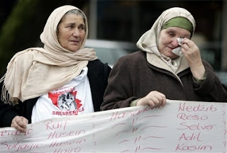 Bosnian women demonstrate outside the International Court of Justice, also known as the World Court, in The Hague, the Netherlands, Monday Feb. 26, 2007. The United Nations' highest court ruled that Serbia failed to use its clear influence with Bosnian Serbs to prevent the genocide of Bosnian Muslims at Srebrenica, but exonerated Serbia of direct responsibility for genocide or complicity in genocide in Bosnia during the 1992-95 war. The court began delivering a historic ruling Monday on whether Serbia is responsible for genocide through the killing, torture, rape and expulsion of Bosnian Muslims. It is the first time an entire nation is being held to judicial account for the ultimate crime.
