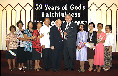 Ptr. Lyons and Dr. Carter with some of BBC Sta. Mesa's charter members