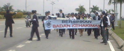 banner bearers leading the Long March for Justice