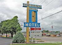Rotating sign in front of the Golden Door Motel in Osage Beach, Missouri